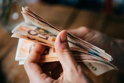 Hands holding european Euro bills