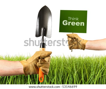 Hands holding garden trowel and sign on white background - stock photo