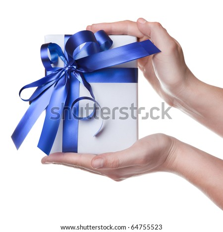 Hands holding gift in package with blue ribbon isolated on white - stock photo