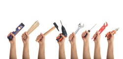 Hands holding hand tools isolated on white background