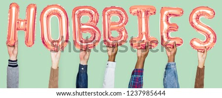 Hands holding hobbies word in balloon letters