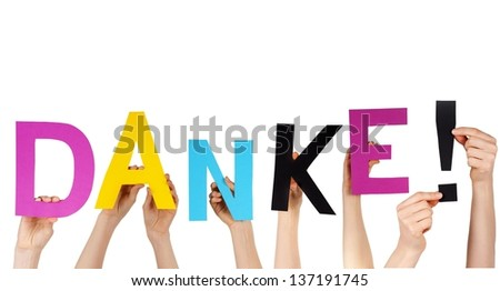 hands holding letters building the german word DANKE!, which means thanks in english, isolated