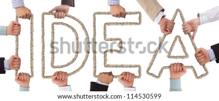 Hands holding letters forming Idea tag