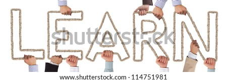 Hands holding letters forming LEARN tag