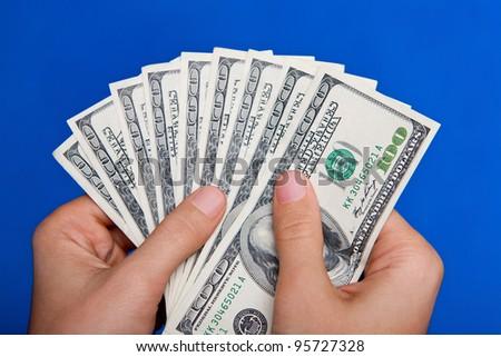 hands holding money US dollar bills