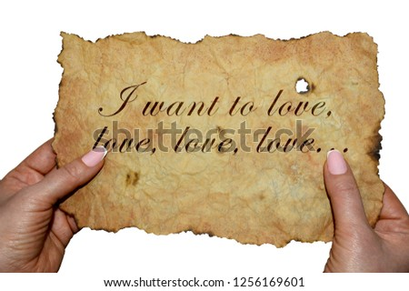 "Hands holding old parchment with the words ""I want to love, love, love ..."" #1256169601"