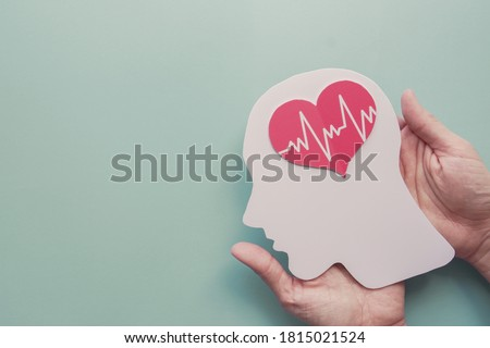 Hands holding paper brain and heart, brain stroke, world heart day, world mental health day, Alzheimer and wellness concept