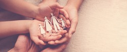 hands holding paper family cutout, family home, foster care, homeless support,world mental health day, Autism support,homeschooling education, domestic violence, social distancing concept