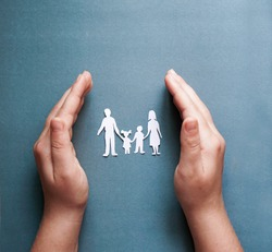 hands holding paper family cutout, social distancing concept, covid19  on the blue color background, family protection