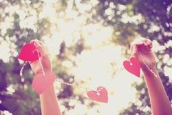 Hands holding paper heart . Instagram effect