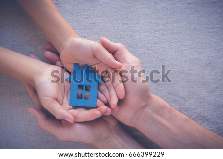 hands holding paper house, family home, homeless housing, mortgage crisis and home protecting insurance concept, international day of families, foster home care, family day care, social distancing