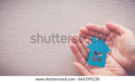 hands holding paper house, homeless housing shelter and real estate , family house insurance, social distancing, homeschool concept