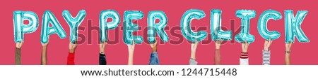 Hands holding pay per click word in balloon letters