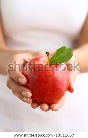Hands holding red apple