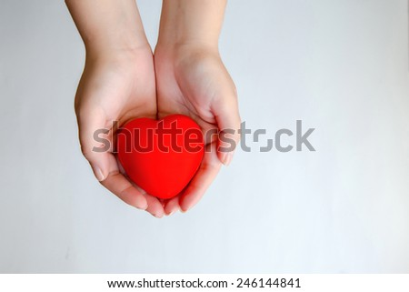 Hands holding red heart isolated #246144841