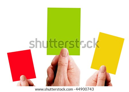 Hands holding red, yellow and green cards