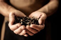 Hands holding set of cringles. Man manufacture concept