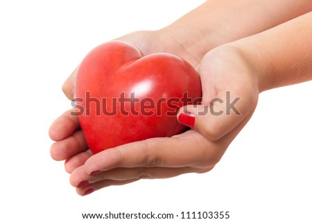 Hands holding shiny heart
