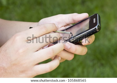 Hands holding smart phone.