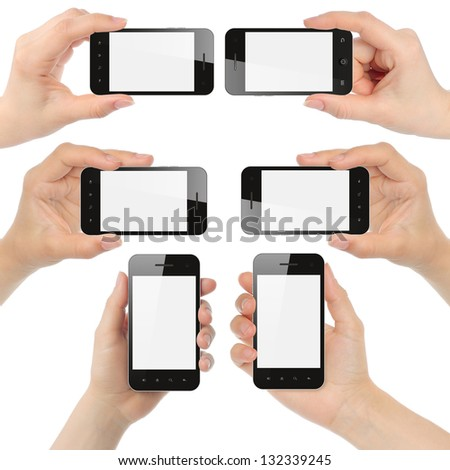 Hands holding smart phones isolated on white background