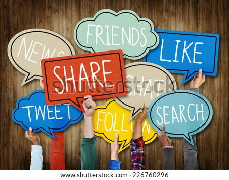 Hands Holding Speech Bubbles with Social Media Words