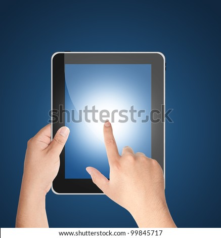 Hands holding tablet PC with blank blue screen isolated on blue background
