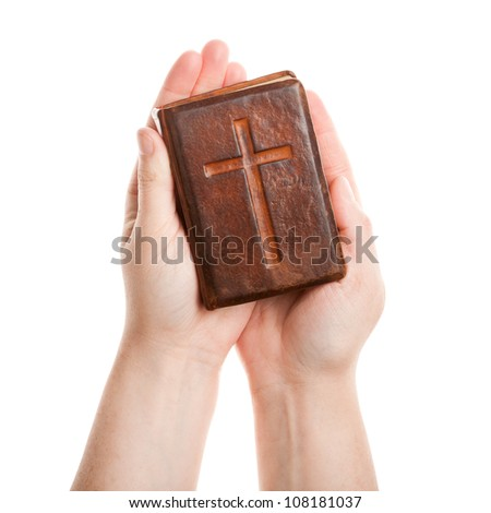 Hands holding the old bible isolated on white