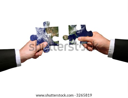 hands holding two jigsaw puzlle for joining