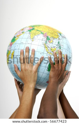 Hands holding up a globe, on white background - stock photo