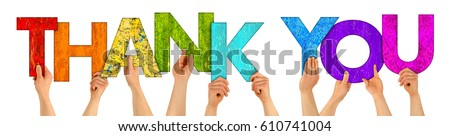 Photo of  hands holding up colorful wooden letters shaping the word thank you isolated on white background