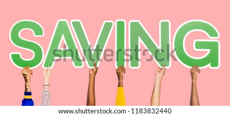Hands holding up green letters forming the word saving