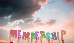 Hands holding up membership against orange and blue sky with clouds