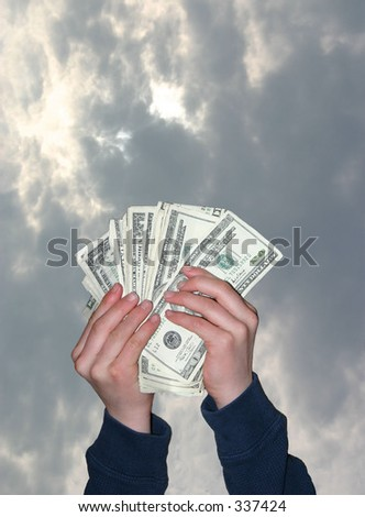 Hands holding up money