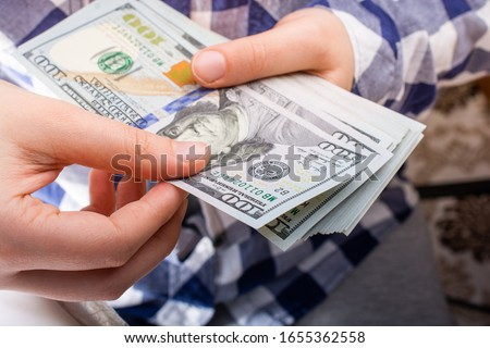 Hands holding USD dollar  banknotes currencies as  financial activity
