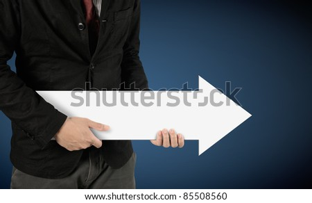 hands holding white arrow sign (path in side) - stock photo