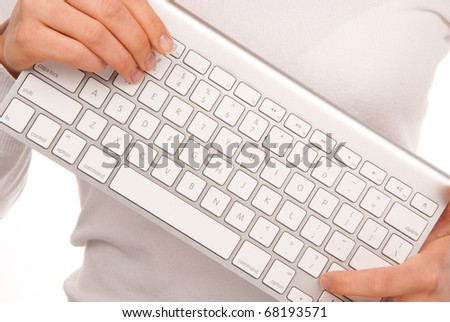Hands holding white remote laptop keyboard modern and stylish that can be connected to PC computer wirelessly isolated on white background