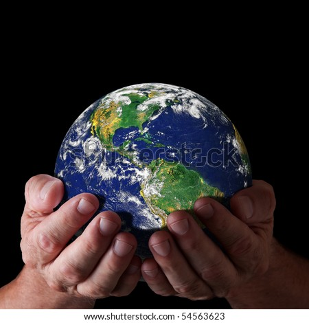 Hands holding world with north and south america. Earth image courtesy of NASA