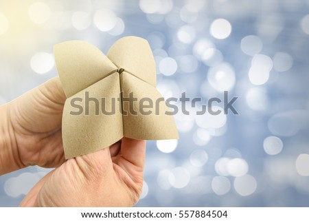Hands in a paper fortune teller make multiple decisions. The person operating the fortune teller manipulates the device based on choices made by player, and finally one of hidden messages is revealed. #557884504
