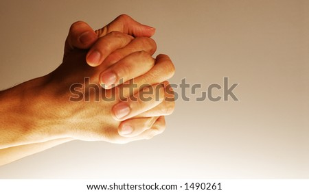 Hands in action - Clasped hands in position of prayer, concept for hoping, etc.