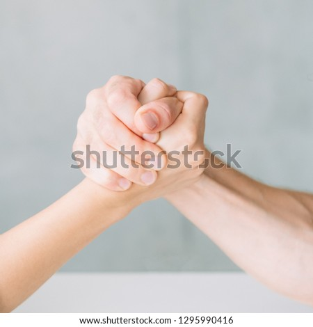hands in arm wrestling competition. fight conflict and rivalry concept. #1295990416