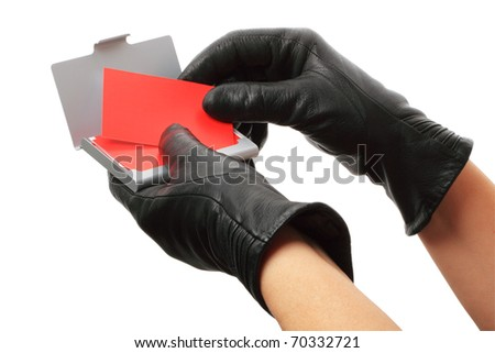 Hands in black leather gloves with red business cards isolated on white background.
