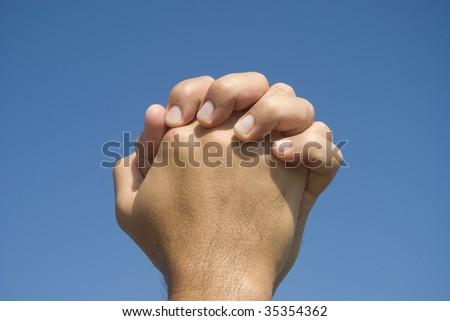 Hands in prayer gesture