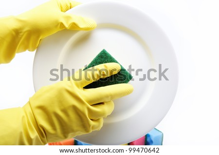 Hands in rubber gloves can sponge the plate on a white background.
