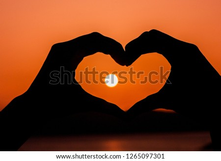 Hands in shape of love heart. Love is in the air. Valentines day. Valentines day greeting card #1265097301