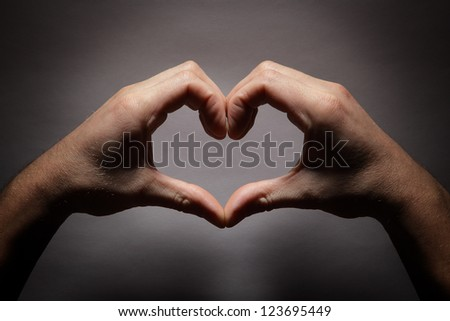 Hands in the shape of a heart #123695449