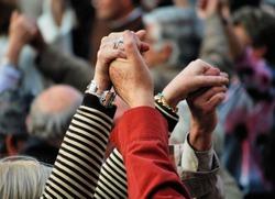 hands in traditional national katolonsky dance sardana, barcelona, spain