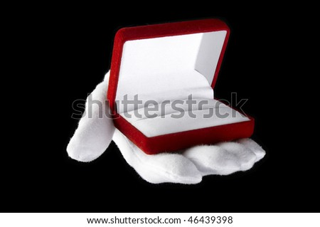 hands in white gloves presented with an open box for jewelry - stock photo