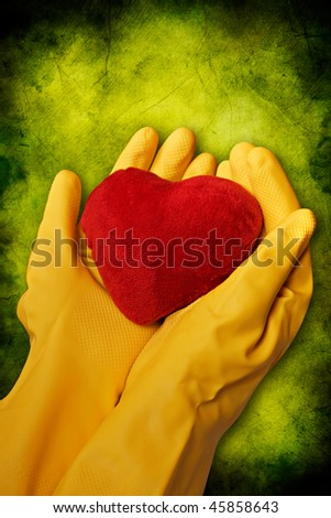hands in yellow gloves hold red heart