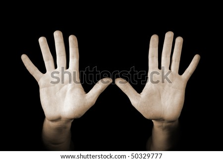 Hands isolated on black background