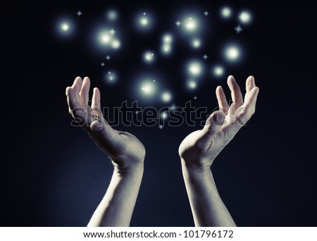 Hands joined together with glow light